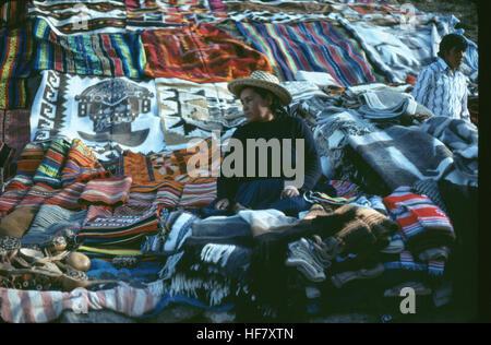 Display of handmade carpets at roadside; near Cuzco, Peru. - Stock Image