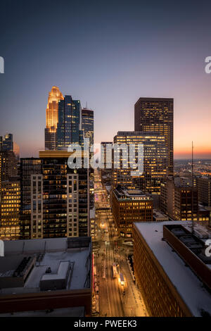 Minneapolis, Minnesota skyline at sunset as seen from the 26th floor of the 365 Nicollet apartment tower. - Stock Image