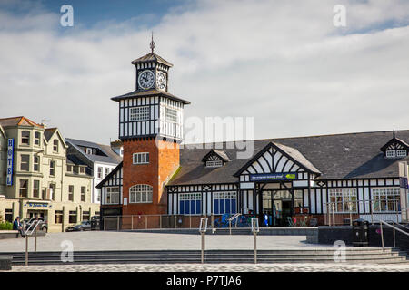 UK, Northern Ireland, Co Antrim, Portrush, Kerr Street, half timbered clock tower of the old Railway Station, now the Original Factory Shop - Stock Image