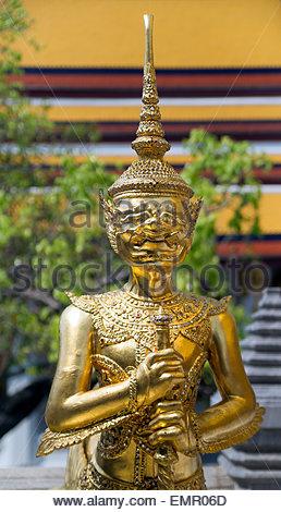 Temple of the Emerald Buddha - Wat Phra Kaew - in Bangkok (Thailand) : demon guard (yaksha) - Stock Image