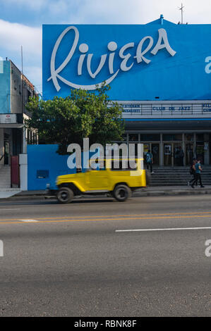 Old American car speeding past the Riviera cinema in Havana, Cuba - Stock Image