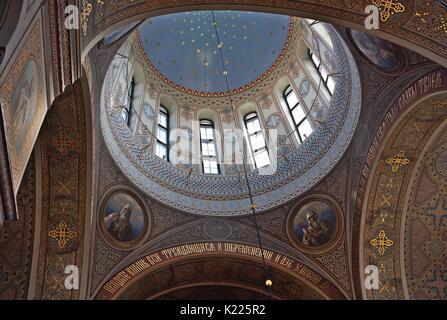 Golden colorful dome inside Uspenski Cathedral, Uspenskin katedraali, Helsinki, Finland, old cyrillic characters, stars, - Stock Image