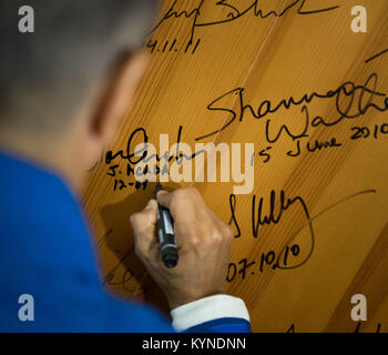 Expedition 53 flight engineer Joe Acaba of NASA signs a door in the Cosmonaut Hotel in advance of his launch onboard - Stock Image