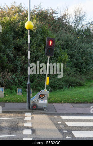Temporary pedstrian crossing control to allow for roadworks - Stock Image