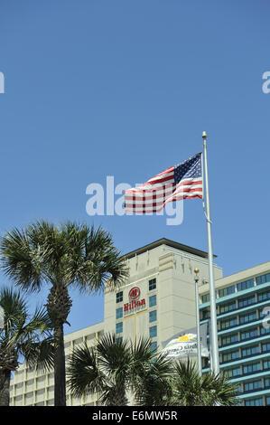 Hilton Hotel and American Flag. Daytona Beach, Florida, USA - Stock Image