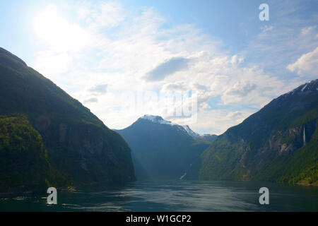 geirangerfjord with the seven sisters and rock scenery, backlit scenery in geirang in norway - Stock Image