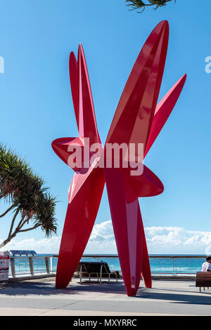 Commemorative installation marking the occasion of the Gold Coast hosting the 2018 Commonwealth Games. Symbolising surfboards and flowers springing to - Stock Image