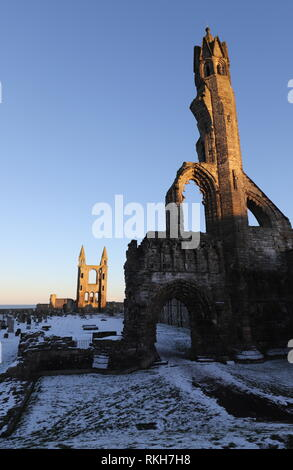 Ruin of St Andrews cathedral at dusk with snow Scotland  February 2019 - Stock Image