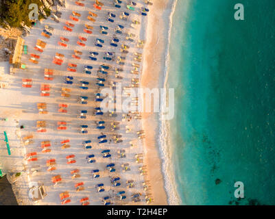 Sunchairs and umbrellas on the beach at Marble Beach, Thassos - Stock Image