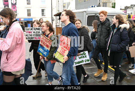 Brighton, UK. 15th Mar, 2019. Students and schoolchildren start to gather in Brighton to take part in the second Youth Strike 4 Climate protest today as part of a co-ordinated day of global action. Thousands of students and schoolchildren are set to go on strike at 11am today as part of a global youth action protest over climate change Credit: Simon Dack/Alamy Live News - Stock Image