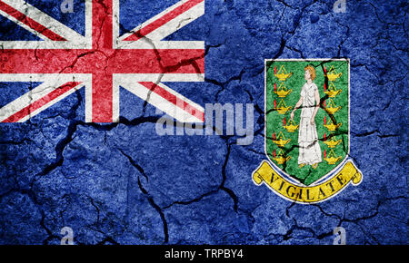 Flag of the British Virgin Islands on dry earth ground texture background - Stock Image