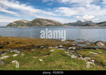 Landscape with mountanious coast line of a fjord. - Stock Image