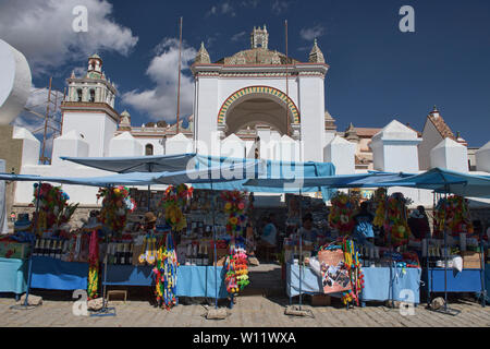 Champagne, flowers and other items sold for car blessings, a unique ritual at the Basílica de Nuestra Señora in Copacabana, Bolivia - Stock Image