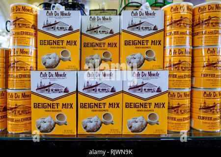Retail store shelf with boxes and cans of Cafe Du Monde Beignet Mix French Doghnuts donuts, New Orleans French Quarter, New Orleans, Louisiana, USA. - Stock Image