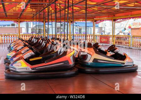 Bumper cars or dodgems at a funfair or amusement park - Stock Image