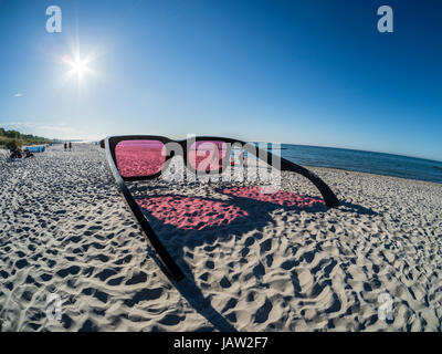 Oversized pair of sunglasses at the beach, art installation during fotofestival 'Horizonte Zingst', fisheye - Stock Image