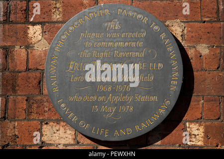 UK, Cumbria, Eden Valley, Appleby Station, memorial plaque to Bishop Eric Treacy who died on the platform in 1978 - Stock Image