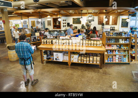 Employee taking inventory at the Coffee by Design shop inside L.L. Bean store in Freeport, Maine, USA. - Stock Image