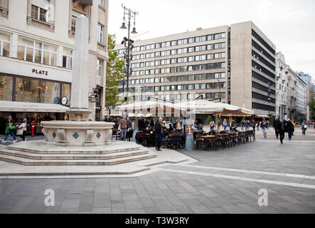 BUDAPEST, HUNGARY - SEPTEMBER 20, 2017: The square in front of St. Stephens Basilica in Budapest, is surrounded by restaurants and patios where many p - Stock Image