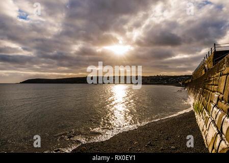 Sunburst over Newlyn and Penzance Bay, Penzance, Cornwall, UK - Stock Image