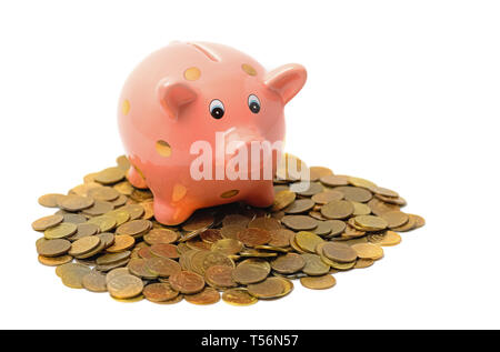 Piggy bank and coins isolated on white - Stock Image