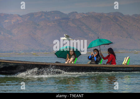 Tourist boat on the Inle lake - Stock Image