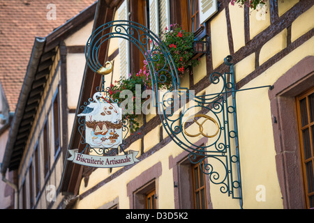Inn sign of Biscuitere Artisanale in Kaysersberg, along the Wine Route, Alsace Haut-Rhin France - Stock Image