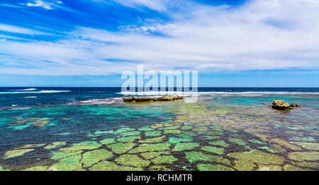 Limestone coral reef and coastline at Little Salmon Bay. - Stock Image