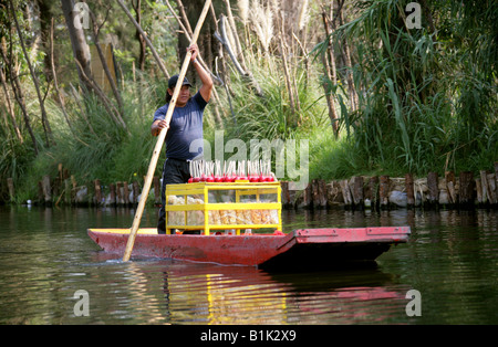 Man Selling Toffe Apples and Sweetmeats on a Boat on the Canals of the Floating Gardens of Xochimilco Mexico City - Stock Image