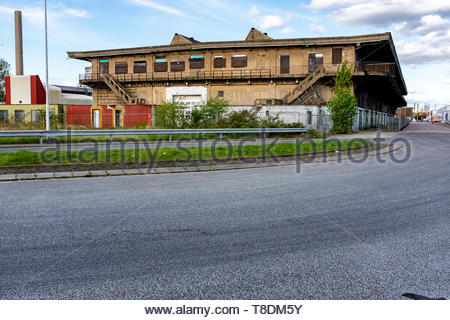 Rotterdam, Netherlands. Neglected and Forsaken Exterior of a Port of Rotterdam Dock Warehouse, waiting for a new, Industrial Purpose or demolishment. - Stock Image