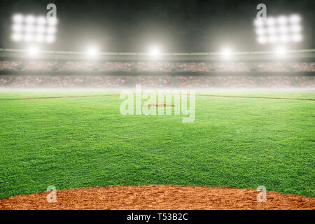 Baseball field at brightly lit outdoor stadium. Focus on foreground and shallow depth of field on background and copy space. - Stock Image