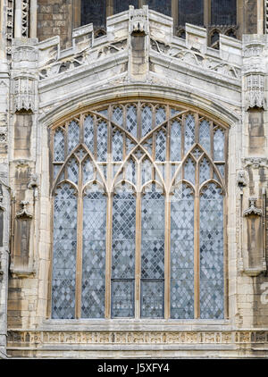 Window above the entrance door at the west facade of the medieval christian cathedral at Peterborough, England. - Stock Image