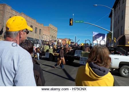 Wyoming University Homecoming Parade making its way through Laramie, in Wyoming, USA. - Stock Image