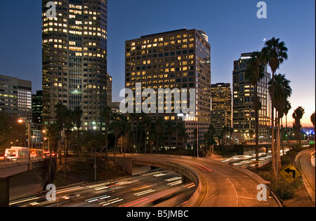 US 101, Harbor Freeway LA skyline High Rise buildings Dusk Los Angeles, California, USA Traffic moving CA los angeles - Stock Image