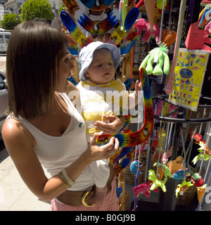 Mother and toddler shopping for souvenirs, Mijas Pueblo, Costa del Sol, Andalucia, Spain - Stock Image