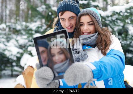 Hey baby, smile! I'm taking selfie by digital tablet. Debica, Poland - Stock Image