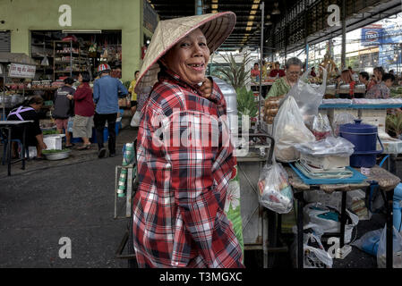 Thailand woman wearing a traditional rice hat aka Chinese coolie hat - Stock Image