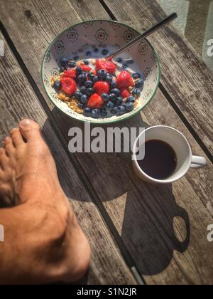 Breakfast of serials, beries and coffee - Stock Image