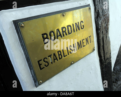 An old brass sign of an official boarding establishment IE an hotel or B&B ( bed and breakfast ) in Dorchester - Stock Image