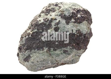 Tremolite-magnetite rock (iron ore). Light green is amphibole group mineral tremolite. Dark is iron oxide magnetite. - Stock Image