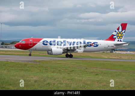 On the runway at Inverness Dalcross Airport in Scotland UK is a once weekly Summer flight from Zurich, Switzerland. - Stock Image