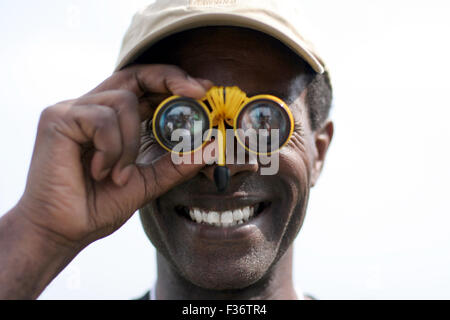 Yellow binoculars Indian explorer - Stock Image