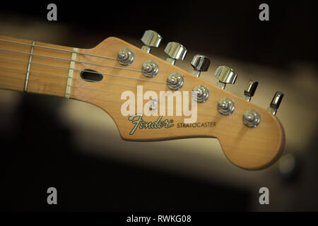 headstock of a Fender Stratocaster electric guitar - Stock Image