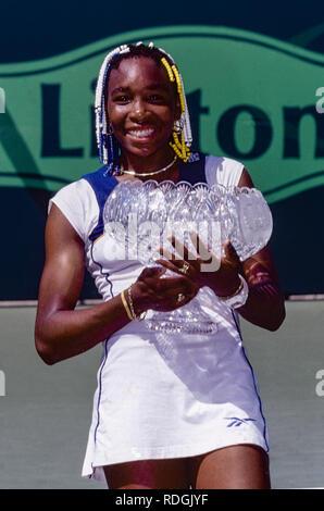 Venus Williams competing at the 1998 Lipton Tennis Championships - Stock Image