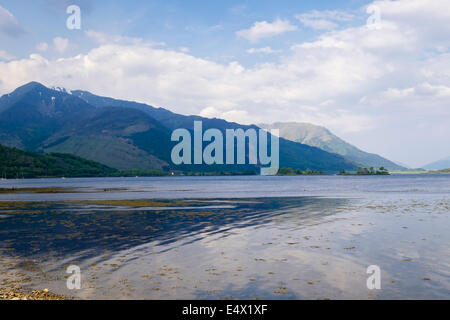 View across sea Loch Leven to mountains in summer at high tide from Invercoe, Glencoe, Highland, Scotland, UK, Britain - Stock Image