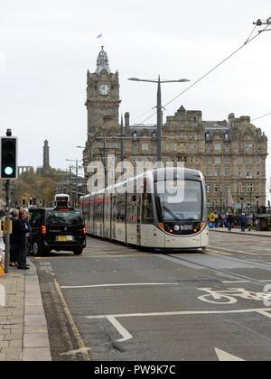 An Edinburgh tram proceeding east along Princes street in Edinburgh city centre, Scotland, UK, Europe - Stock Image