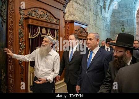 U.S. Secretary of State Mike Pompeo, center, tours the Western Wall and Tunnels with Israeli Prime Minister Benjamin Netanyahu, right, March 21, 2019 in Jerusalem, Israel. - Stock Image