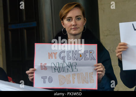 London, UK. 19th October 2018. A protester holds a poster 'My Gender Is Mine To Determine' outside the Daily Mail building following articles demonising trans people, particularly trans women, in The Metro which they publish, and their printing an advertisement campaign for the hate group, 'Fair Play for Women'.  Thousands have complaine Credit: Peter Marshall/Alamy Live News - Stock Image