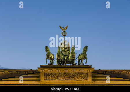 Quadiga on top of Brandenburg gate in Berlin - Stock Image