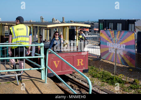 17th May, 2018. On the first day of the festival, access to The Great Escape Festival's new beach site is held up to allow the reinstated Volks Electric Railway to pass throughCredit: Scott Hortop Travel/Alamy Live News - Stock Image